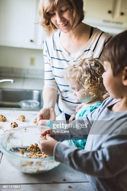 Children Baking Cookies with Mom