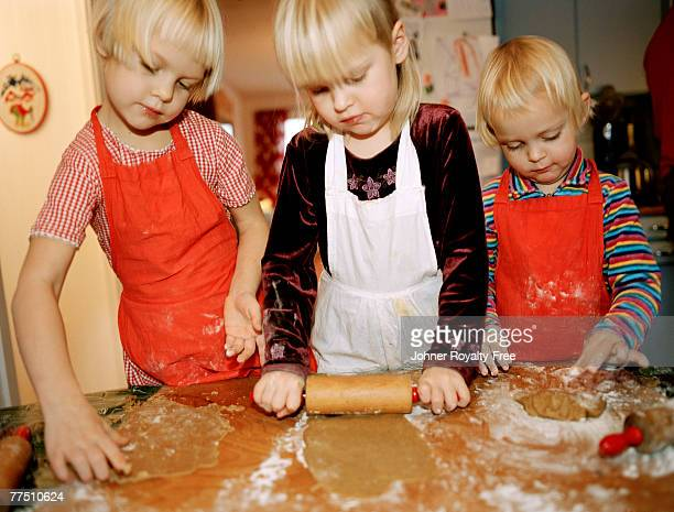 Children baking gingerbread cookies.