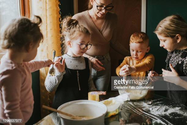 children baking with mum - women whipping men stock pictures, royalty-free photos & images