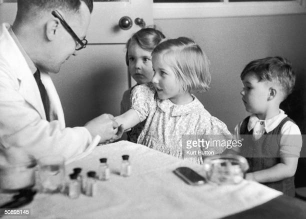 Children being inoculated against diphtheria 29th July 1944 Original Publication Picture Post 1760 What We Can Do For Everyone's Child pub 1944