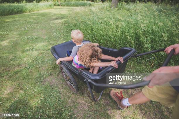 Children Being Pushed In a Wheelbarrow