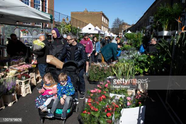 Children being pushed through Columbia Road flower market on Mother's Day and it's last open Sunday for a while due to Covid19 on what would normally...