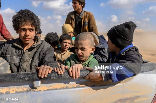 Children believed to be from the Yazidi community who were captured by Islamic State group fighters are pictured after being evacuated from the IS'...