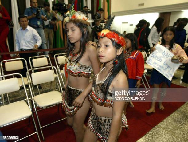 Children belonging to the Amazonian Huaorani ethnic group leave 22 November, 2005 the Congress building in Quito. Indigenous children from several...
