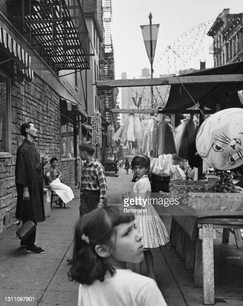 Children beside a market stall in the Little Italy district of the borough of Manhattan in New York City, New York, circa 1955.