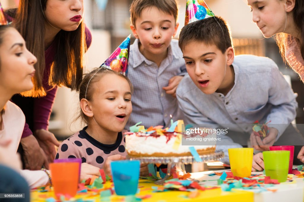 Children Blowing candles on a Birthday party : Stock Photo