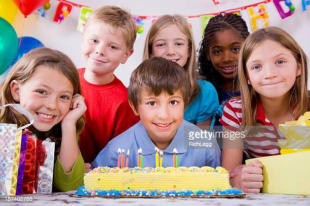 Children Blowing Out Candles on a Birthday Cake
