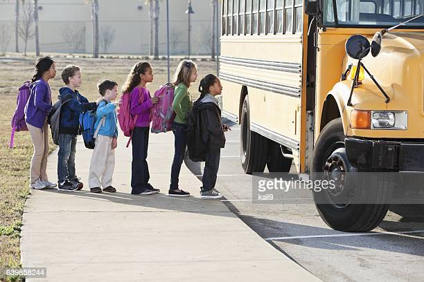 Children boarding school bus