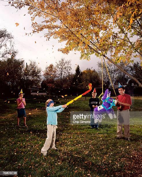Children breaking pinata