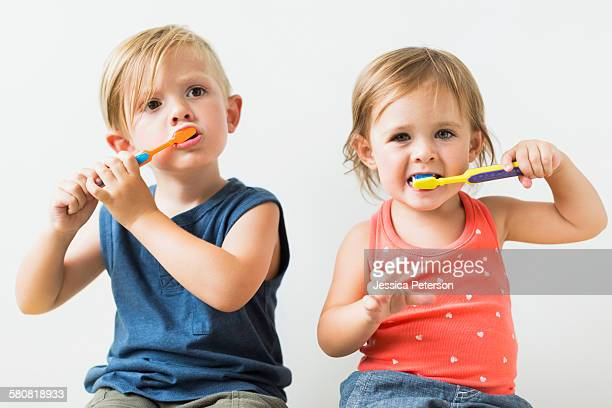 Children (2-3) brushing teeth