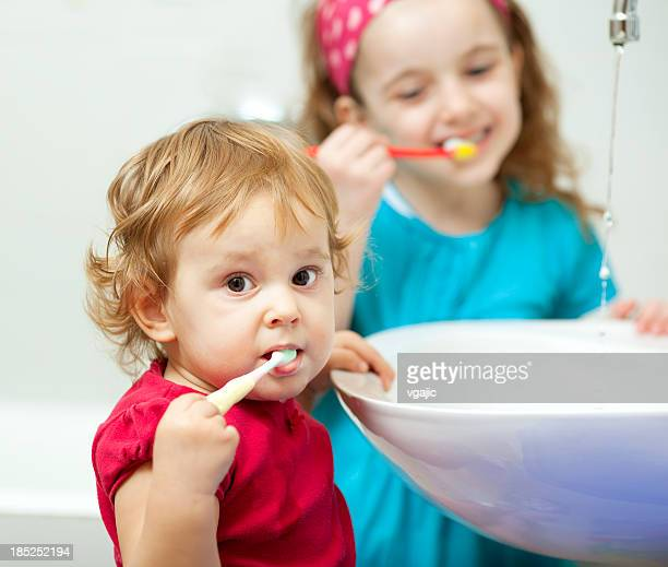 Children Brushing Teeth Together