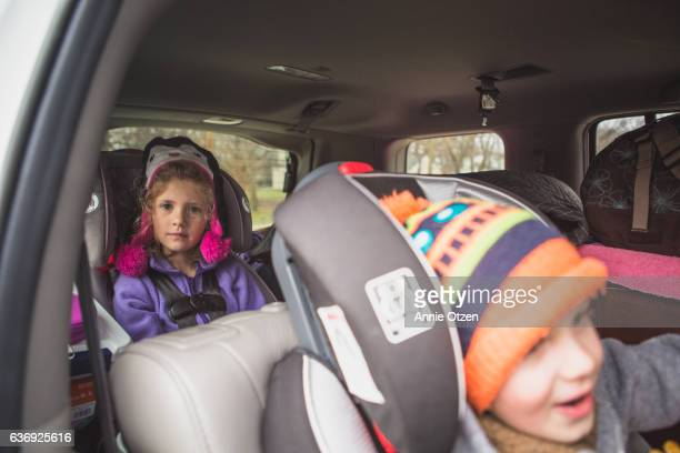children buckled in car seats - buckle stock pictures, royalty-free photos & images
