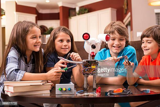 Children build robot together at home.