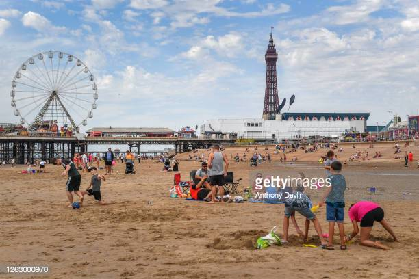 Children build sandcastles as people enjoy the warm weather on the Blackpool Beach on July 31 2020 in Blackpool England High temperatures are...