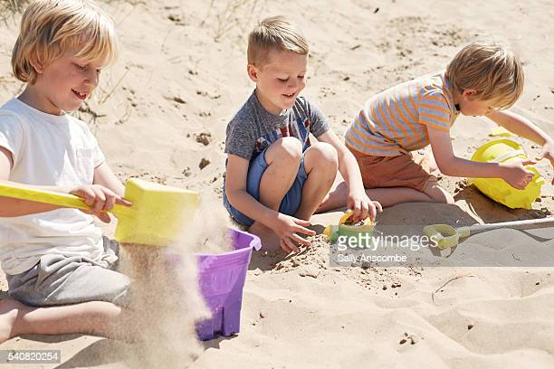 Children building a sandcastle on the beach