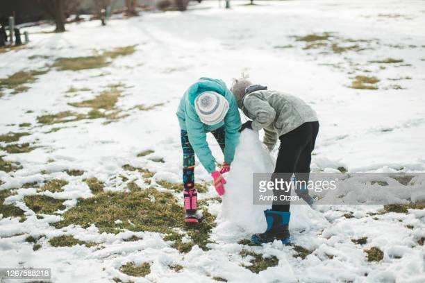 children building snow sculpture - sioux falls stock pictures, royalty-free photos & images