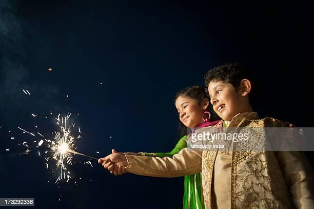 Children burning fire crackers on Diwali