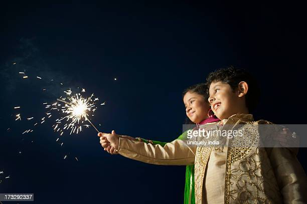 Children burning fire crackers on Diwali