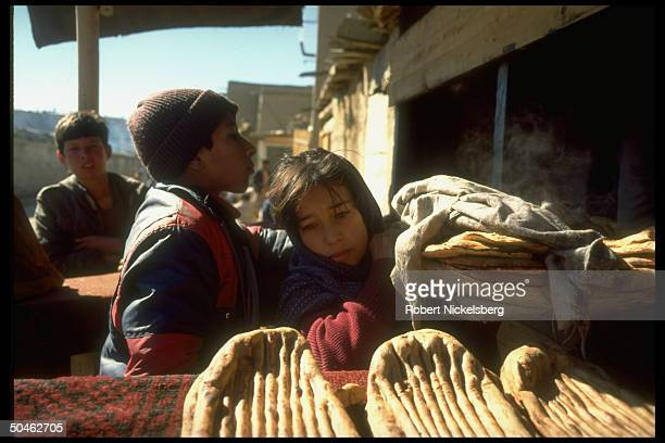 Children buying/selling bread going at high prices Kabul