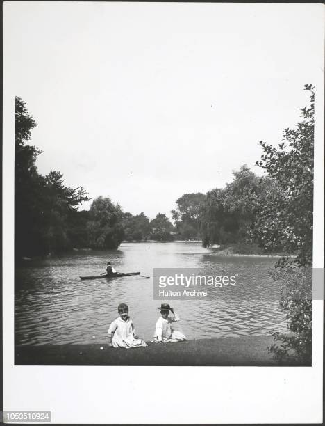 Children by the lake in Battersea Park London circa 1890