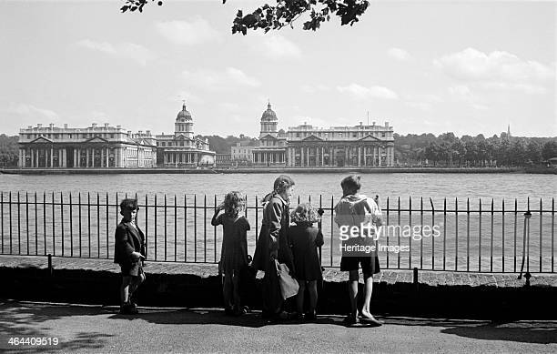 Children by the River Thames London c1945c1965 A group of children in Island Gardens Poplar Tower Hamlets London look across the River Thames towards...