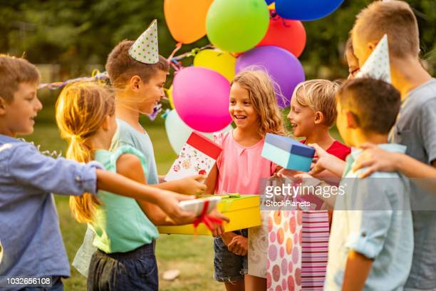 children came to birthday party with presents - birthday gift stock pictures, royalty-free photos & images