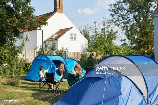 children camping out in their back garden - richard drury stock pictures, royalty-free photos & images