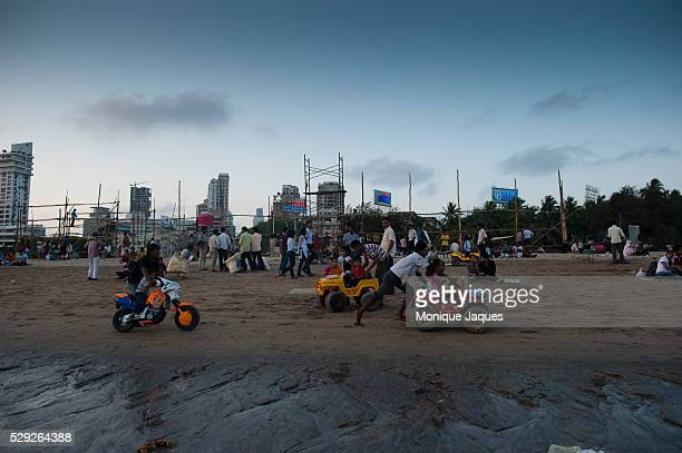 Children can ride plastic vehicles for several rupees a ride Locals and tourists visit Chaowpatty Beach in Mumbai Traditionally the site of the...