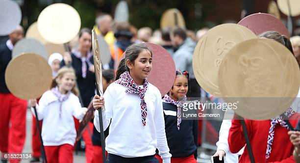 Children carry medals during a Rio 2016 Victory Parade for the British Olympic and Paralympic teams on October 17, 2016 in Manchester, England.