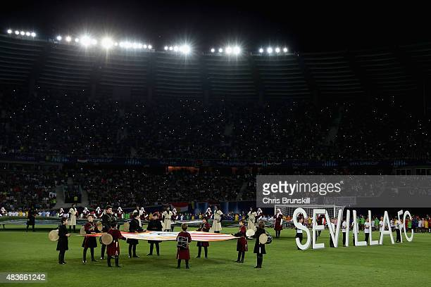 Children carry the Sevilla flag ahead of the UEFA Super Cup between Barcelona and Sevilla FC at Dinamo Arena on August 11 2015 in Tbilisi Georgia