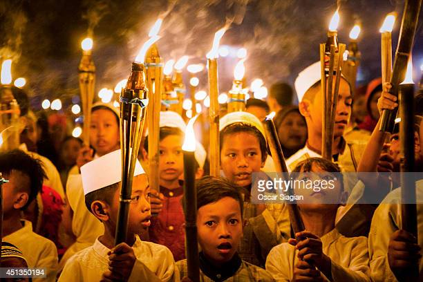 Children carry torches during a procession to celebrate the beginning of the holy month of Ramadan on June 27 2014 in Jakarta Indonesia Ramadan the...