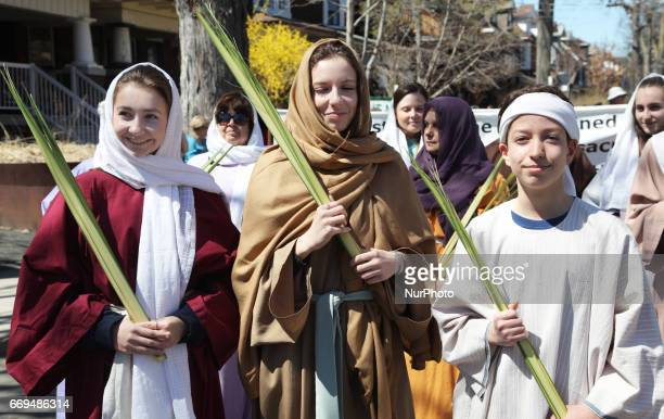 Children carrying a palm leaves during the Good Friday procession in Little Italy in Toronto Ontario Canada on April 14 2017 The Saint Francis of...