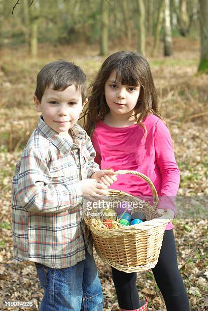 Children carrying basket of Easter eggs