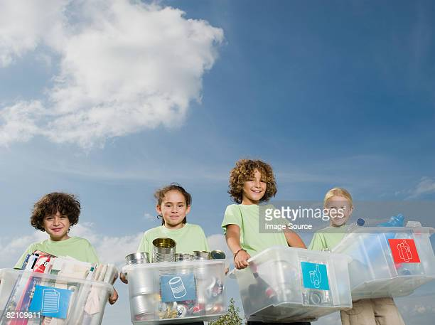 Children carrying boxes of recycling