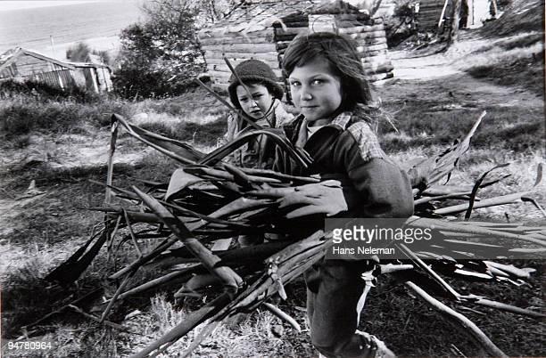 Children carrying firewood, Canelones, Canelones Department, Uruguay