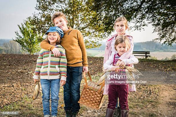 children carrying picnic basket - alexandra dost stock-fotos und bilder