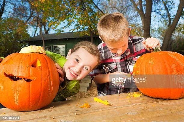 Children Carving Halloween Pumpkins