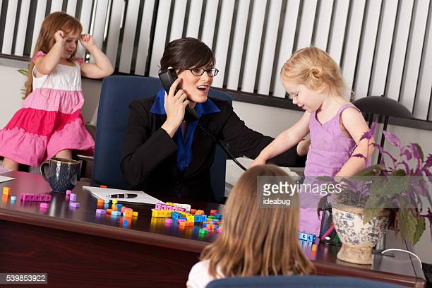 Children Causing Businesswoman Frustration at Work