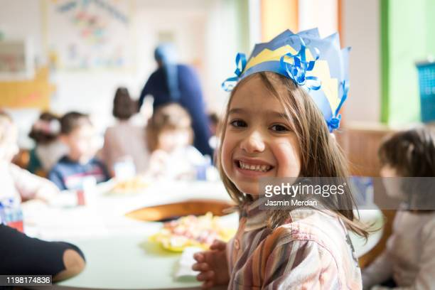 children celebrating birthday together - happybirthdaycrown stock pictures, royalty-free photos & images