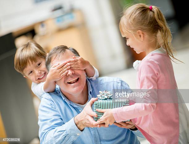 children celebrating father's day - fathers day stock pictures, royalty-free photos & images