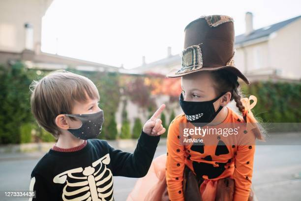 children celebrating halloween during covid-19 pandemic - human skeleton stock pictures, royalty-free photos & images