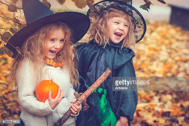 children celebrating halloween - halloween party stock photos and pictures