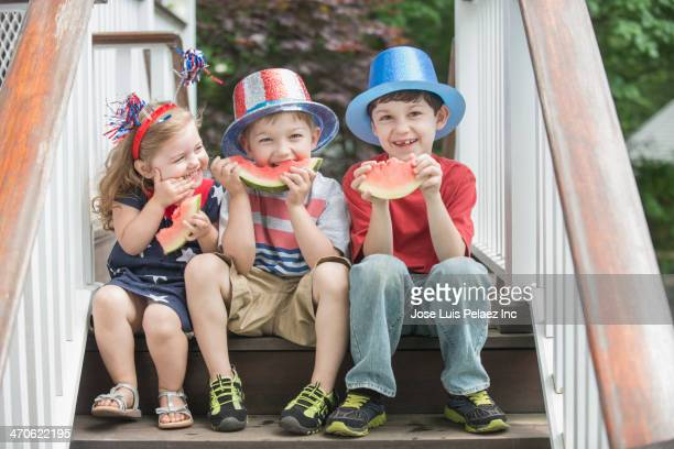 children celebrating independence day together - independence day holiday stock photos and pictures