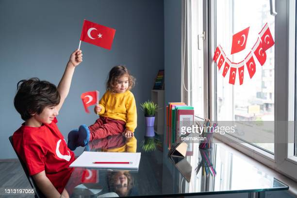 children celebrating national sovereignty and children's day at home - april stock pictures, royalty-free photos & images