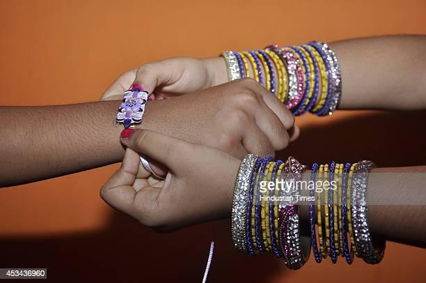 Children celebrating the festival of 'Raksha Bandhan' at Lohiya Nagar on August 10 2014 in Ghaziabad India The festival of Raksha Bandhan' or 'Rakhi'...
