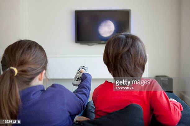 Children changing the television channel