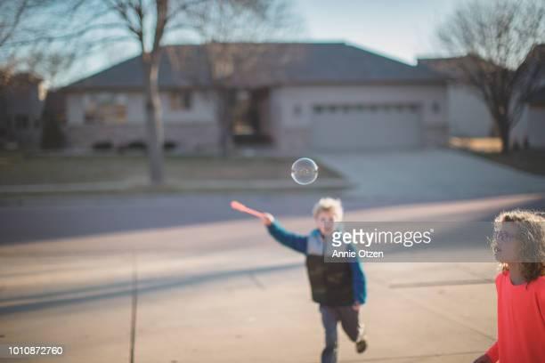 Children Chasing a bubble