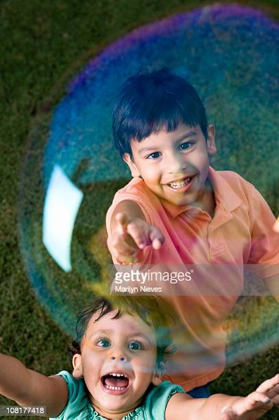 Children Chasing a Bubble