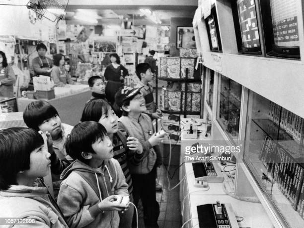 Children check game softwares at a department store on December 26, 1984 in Tokyo, Japan.