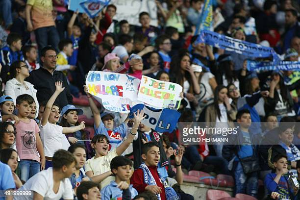 Children cheer in the stands during the Italian Serie A football match between SSC Napoli and Hellas Verona FC in San Paolo Stadium on May 18 2014...